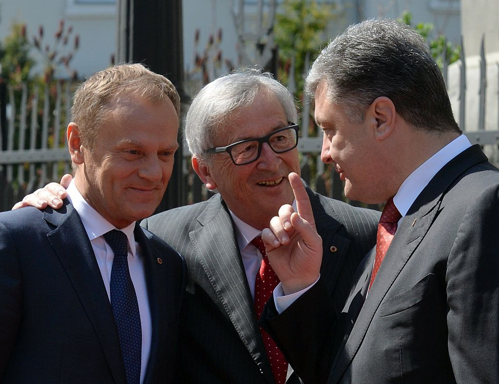 Ukrainian President Petro Poroshenko (R) speaks with Head of the European Commission Jean-Claude Juncker (C) and President of the European Council Donald Tusk (L) before their meeting in Kiev on April 27, 2015. Ukraine and European Union leaders hold a summit expected to discuss peacekeeping troops and a possible aid boost for the debt-mired country, amid a fragile ceasefire between government troops and pro-Russian separatists in the east.  AFP PHOTO / GENYA SAVILOV        (Photo credit should read GENYA SAVILOV/AFP/Getty Images)
