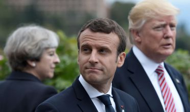 (L-R) Britain's Prime Minister Theresa May, French President Emmanuel Macron and US President Donald Trump attend the Summit of the Heads of State and of Government of the G7, the group of most industrialized economies, plus the European Union, on May 26, 2017 in Taormina, Sicily. The leaders of Britain, Canada, France, Germany, Japan, the US and Italy will be joined by representatives of the European Union and the International Monetary Fund (IMF) as well as teams from Ethiopia, Kenya, Niger, Nigeria and Tunisia during the summit from May 26 to 27, 2017. / AFP PHOTO / POOL / STEPHANE DE SAKUTIN        (Photo credit should read STEPHANE DE SAKUTIN/AFP/Getty Images)