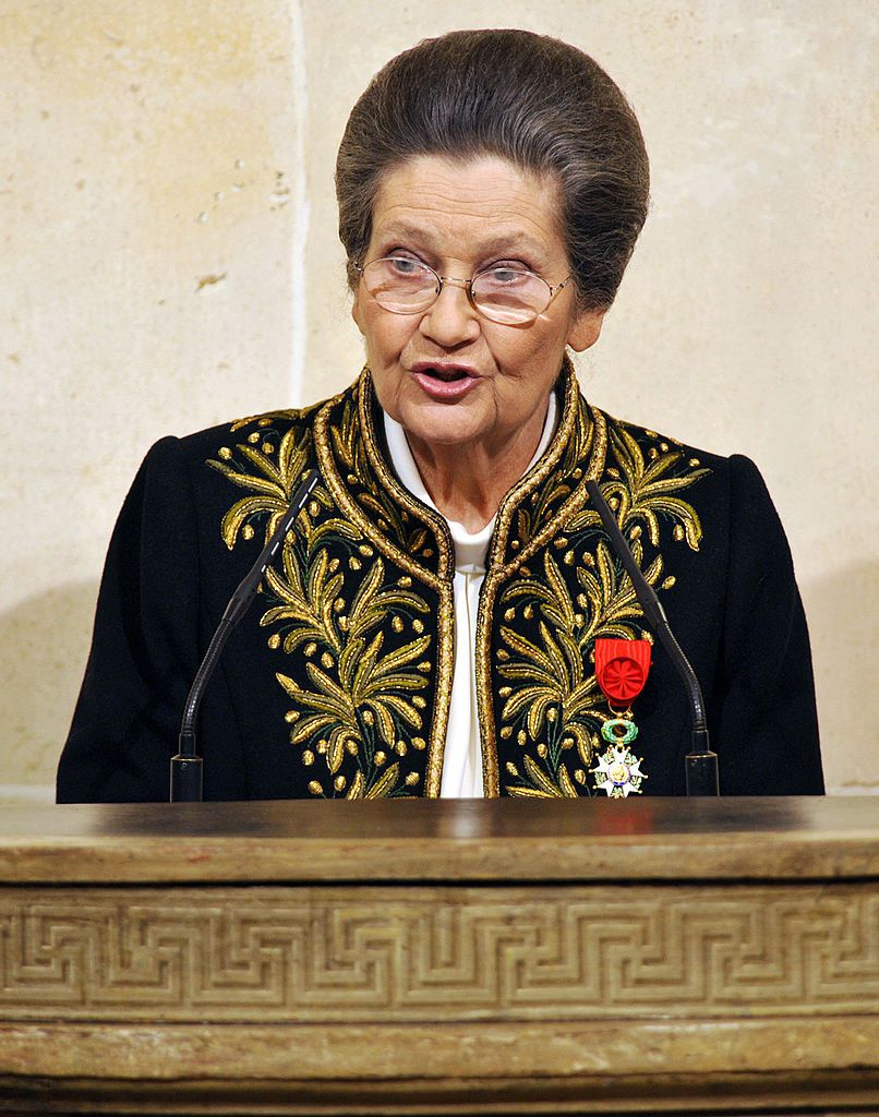 """French Simone Veil, an Auschwitz survivor and the first elected president of the European parliament, delivers a speech as she joined today the prestigious Academie Francaise, the guardian of the French language, on March 18, 2010 at the Institut de France in Paris. The 82-year-old Veil, a former French minister who ranks among the country's most respected politicians, was only the sixth woman to join the """"immortals"""", as the 40 members of the Academie are known. Dressed in the members' traditional green uniform, designed specially for her by Chanel, Veil was presented with the ceremonial sword bearing the inscription """"Liberty, Equality and Fraternity"""". Veil's tattooed Auschwitz prisoner number, 78651, was also engraved on the sword that was presented to her by former president Jacques Chirac during a ceremony at the French Senate.  AFP PHOTO / POOL / PHILIPPE WOJAZER (Photo credit should read PHILIPPE WOJAZER/AFP/Getty Images)"""