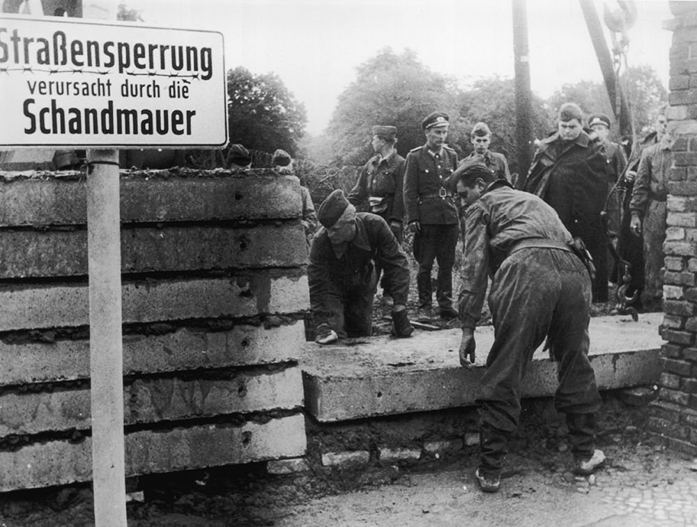 1961:  Soldiers building the Berlin Wall as instructed by the East German authorities, in order to strengthen the existing barriers dividing East and West Berlin.  (Photo by Keystone/Getty Images)