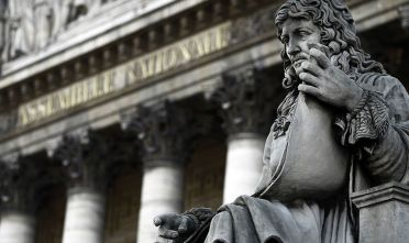 A picture taken on November 16, 2010 in Paris shows a statue representing Jean-Baptiste Colbert (1619-1683) on the frontispiece of the Palais Bourbon where the French National Assembly is located. AFP PHOTO JOEL SAGET (Photo credit should read JOEL SAGET/AFP/Getty Images)