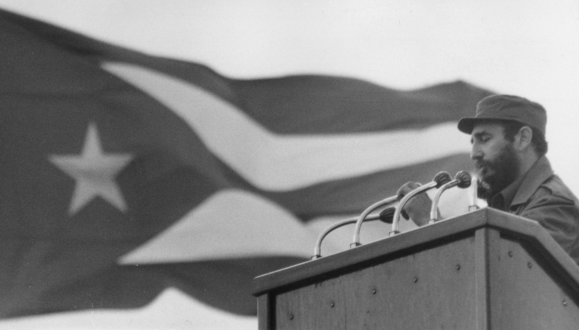 17th December 1969:  Fidel Castro giving a speech  with the national flag of Cuba in the background.  (Photo by Keystone/Getty Images)