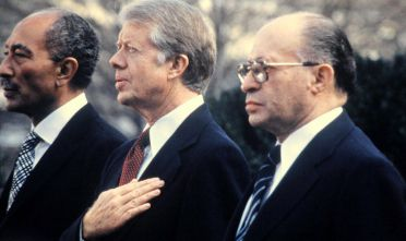 Il presidente egiziano Anwar al-Sadat, il presidente Usa Jimmy Carter e il premier israeliano Menachem Begin  a Camp David, 1978 (Fotot: Getty Images).