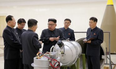 "This undated picture released by North Korea's official Korean Central News Agency (KCNA) on September 3, 2017 shows North Korean leader Kim Jong-Un (C) looking at a metal casing with two bulges at an undisclosed location. North Korea has developed a hydrogen bomb which can be loaded into the country's new intercontinental ballistic missile, the official Korean Central News Agency claimed on September 3. Questions remain over whether nuclear-armed Pyongyang has successfully miniaturised its weapons, and whether it has a working H-bomb, but KCNA said that leader Kim Jong-Un had inspected such a device at the Nuclear Weapons Institute. / AFP PHOTO / KCNA VIA KNS / STR / South Korea OUT / REPUBLIC OF KOREA OUT   ---EDITORS NOTE--- RESTRICTED TO EDITORIAL USE - MANDATORY CREDIT ""AFP PHOTO/KCNA VIA KNS"" - NO MARKETING NO ADVERTISING CAMPAIGNS - DISTRIBUTED AS A SERVICE TO CLIENTS THIS PICTURE WAS MADE AVAILABLE BY A THIRD PARTY. AFP CAN NOT INDEPENDENTLY VERIFY THE AUTHENTICITY, LOCATION, DATE AND CONTENT OF THIS IMAGE. THIS PHOTO IS DISTRIBUTED EXACTLY AS RECEIVED BY AFP.  /         (Photo credit should read STR/AFP/Getty Images)"