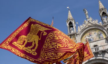 VENICE, ITALY - APRIL 25:  A Venetian flag while Venetians autonomists march in Saint Mark's Square on April 25, 2014 in Venice, Italy. The march, which takes place on St Mark's day, had been banned by the Police for reasons of public order.  (Photo by Marco Secchi/Getty Images)