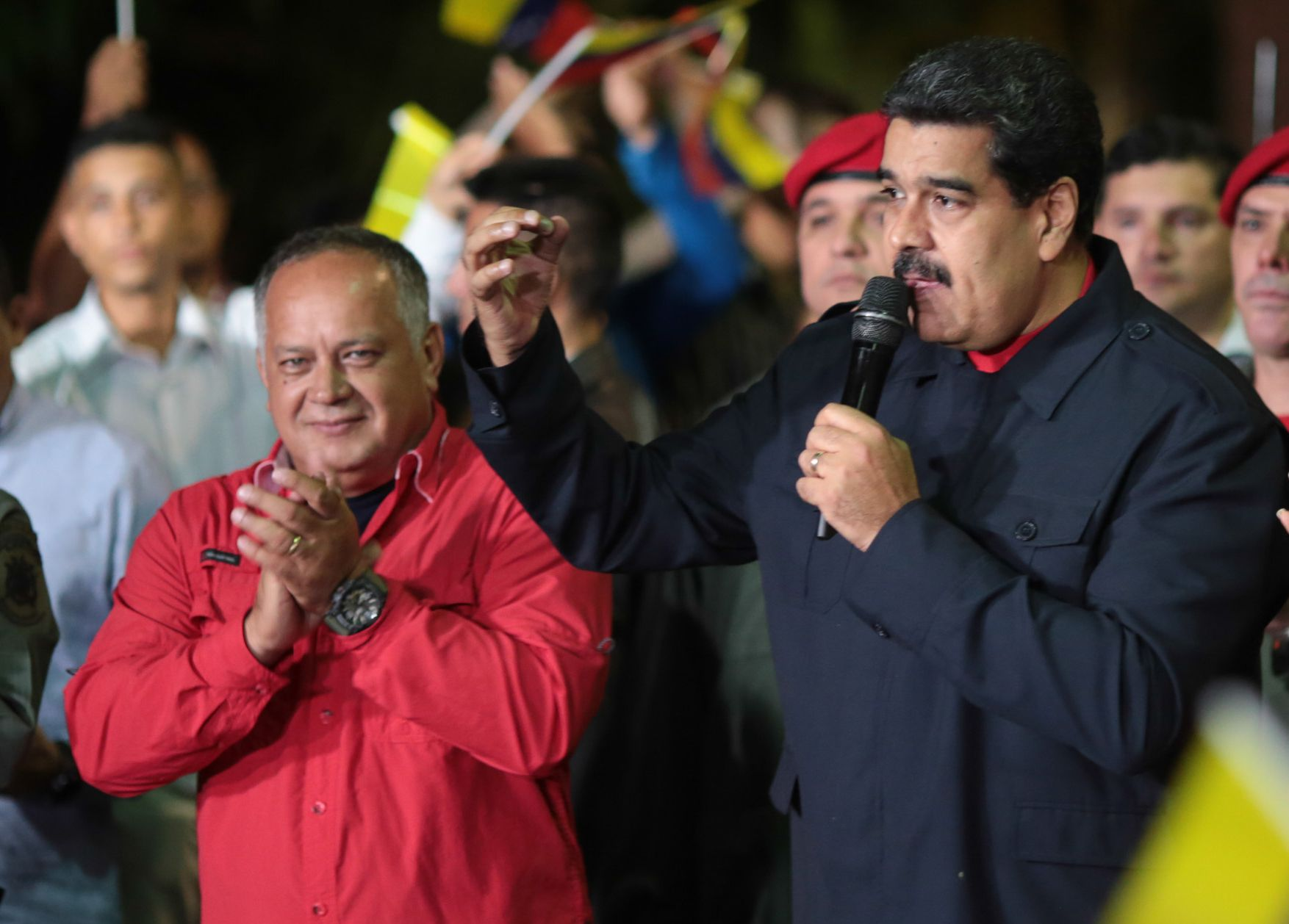 "Venezuelan President Nicolas Maduro (R) speaks beside Diosdado Cabello (L), a member of the Constituent Assembly, in Caracas on October 15,2017, after Maduro's socialist government won a landslide 17 out of 23 states in Venezuela's regional elections, according to official results announced by the National Elections Council. The opposition Democratic Union Roundtable (MUD) coalition, which earlier said the upcoming results were ""suspicious"", took only five of the states, according to the results. / AFP PHOTO / PRESIDENCIA / PRESIDENCIA / == RESTRICTED TO EDITORIAL USE  / MANDATORY CREDIT:  ""AFP PHOTO /  PRRSIDENCIA"" / NO MARKETING / NO ADVERTISING CAMPAIGNS /  DISTRIBUTED AS A SERVICE TO CLIENTS  ==        (Photo credit should read PRESIDENCIA/AFP/Getty Images)"