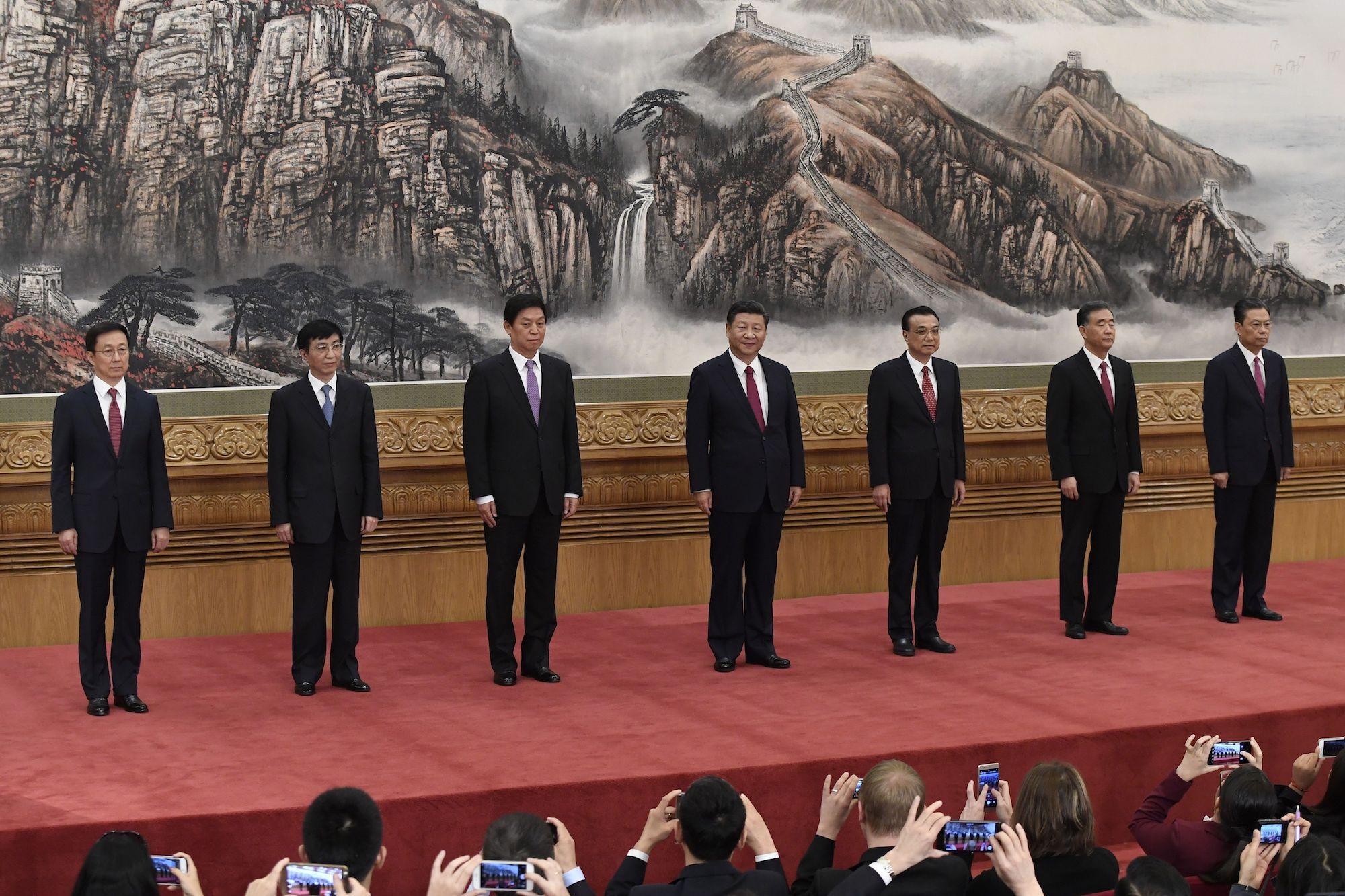 The Communist Party of China's new Politburo Standing Committee, the nation's top decision-making body (L-R) Han Zheng, Wang Huning, Li Zhanshu, Chinese President Xi Jinping, Premier Li Keqiang, Wang Yang, Zhao Leji meet the press at the Great Hall of the People in Beijing on October 25, 2017. China on October 25 unveiled its new ruling council with President Xi Jinping firmly at the helm after stamping his authority on the country by engraving his name on the Communist Party's constitution. / AFP PHOTO / WANG ZHAO        (Photo credit should read WANG ZHAO/AFP/Getty Images)
