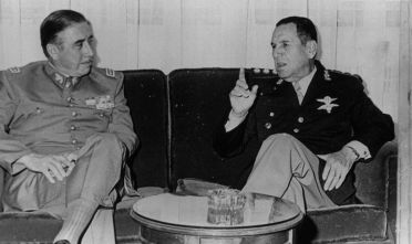 21st May 1974:  General Augusto Pinochet (left), the President of Chile with Juan Peron (1895 - 1974), the Argentinian President in Buenos Aires.  (Photo by Keystone/Getty Images)