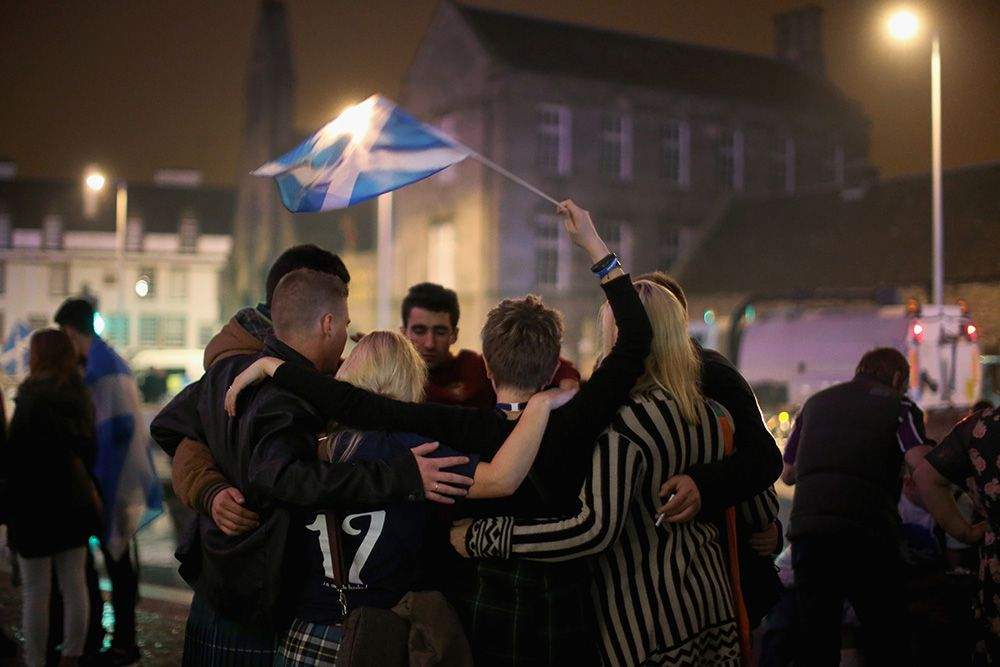 EDINBURGH, SCOTLAND - SEPTEMBER 19:  Yes vote campaigners console themselves outside the Scottish Parliament building after the people of Scotland voted no to independence on September 19, 2014 in Edinburgh, Scotland. The majority of Scottish people have today voted 'No' in the referendum and Scotland will remain within the historic union of countries that make up the United Kingdom.  (Photo by Christopher Furlong/Getty Images)