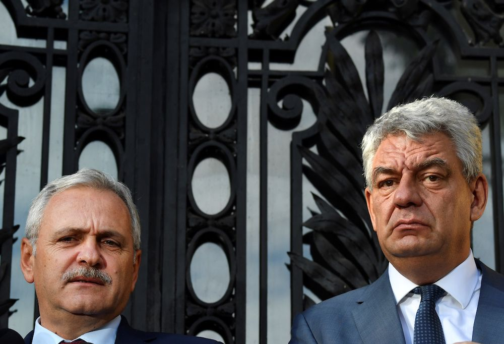 President of Romania's ruling Social Democrat Party (PSD) Liviu Dragnea (L) and Romania's Prime Minister Mihai Tudose (R) speak to the press after a meeting at the PSD party's headquarters in Bucharest on October 10, 2017.  Romanian Prime Minister Tudose and Social Democrat leader Dragnea reached an agreement on October 12, 2017 on a cabinet reshuffle, avoiding a new political crisis three months after the overthrow of the previous left-wing government. / AFP PHOTO / Daniel MIHAILESCU        (Photo credit should read DANIEL MIHAILESCU/AFP/Getty Images)
