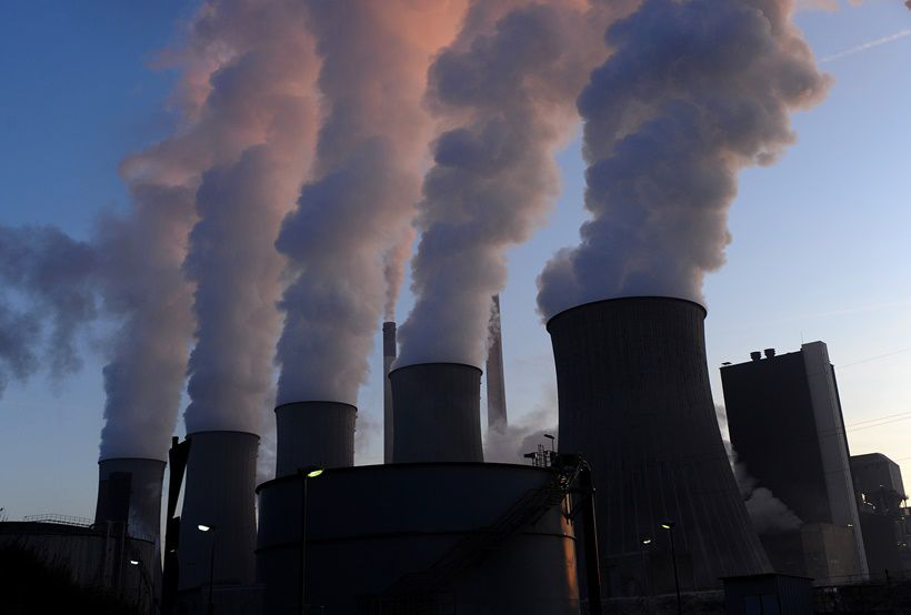 Cooling towers of the coal-fired power plant of Scholven in Gelsenkirchen, western Germany, are pictured on January 16, 2012. According to its operator E.ON, the company's largest power plant has a total net output of 2200 megawatts and is one of the largest hard-coal fired power plants in Europe.        AFP PHOTO / PATRIK STOLLARZ        (Photo credit should read PATRIK STOLLARZ/AFP/Getty Images)