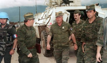 Commander of Serbian forces in Bosnia General Ratko Mladic (C) arrives at the airport of Sarajevo on August 10, 1993 in order to negociate the withdrawal of his troops from Mount Igman. The Bosnian-Hercegovina peace talks session in Geneva were cancelled on August 12 because Serbian forces reportedly still occupied the strategic heights. AFP PHOTO GABRIEL BOUYS (Photo credit should read GABRIEL BOUYS/AFP/Getty Images)
