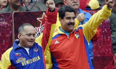 Venezuelan President Nicolas Maduro (R) and the president of the National Assembly, Diosdado Cabello salute after receiving the decree powers law, in Caracas on March 15, 2015. Venezuela's National Assembly voted Sunday to give President Nicholas Maduro decree-making powers in defense and security affairs amid an escalating confrontation with Washington. The special powers were approved by a show of hands in the assembly after two hours of debate and will be in effect for six months.    AFP PHOTO/JUAN BARRETO        (Photo credit should read JUAN BARRETO/AFP/Getty Images)