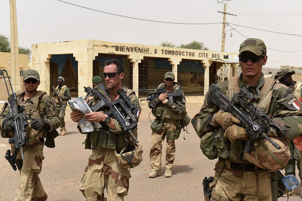 """French soldiers of the 93rd Mountain Artillery Regiment and soldiers of the Malian Armed Forces patrol on June 6, 2015 in Timbuktu, during the joint operation """"La Madine 3"""" part of the French Army's """"Operation Barkhane"""", an anti-terrorist operation in the Sahel. AFP PHOTO/PHILIPPE DESMAZES        (Photo credit should read PHILIPPE DESMAZES/AFP/Getty Images)"""