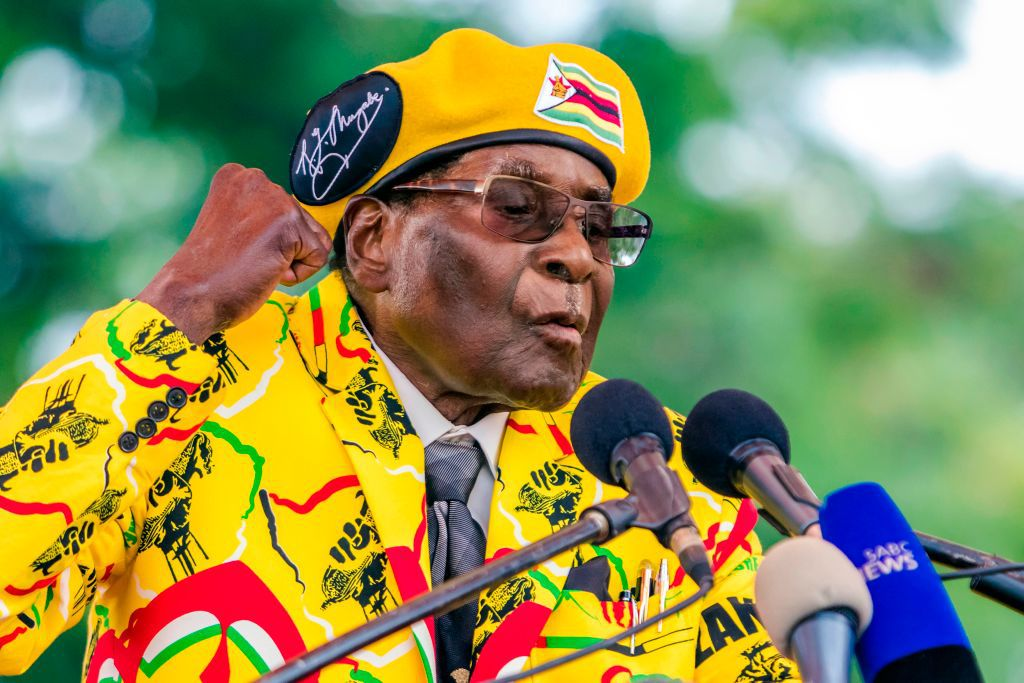 Zimbabwe's President Robert Mugabe addresses party members and supporters gathered at his party headquarters to show support to Grace Mugabe becoming the party's next Vice President after the dismissal of Emerson Mnangagwa November 8 2017. Zimbabwe's sacked vice president, Emmerson Mnangagwa, said on November 8, 2017, he had fled the country, as he issued a direct challenge to long-ruling President Robert Mugabe and his wife Grace. / AFP PHOTO / Jekesai NJIKIZANA        (Photo credit should read JEKESAI NJIKIZANA/AFP/Getty Images)