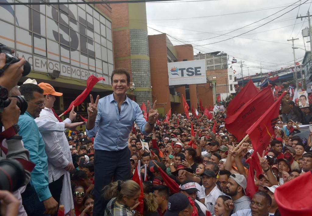 Presidential candidate for the Honduran Opposition Alliance against the Dictatorship, Salvador Nasralla is greeting by supporters in front the Supreme Electoral Tribunal (TSE) in Tegucigalpa, on November 27, 2017.  Hondurans waited Monday to learn who would be their next president after both leftist TV host-turned-politician Salvador Nasralla and the incumbent Juan Orlando Hernandez claimed victory -- and as the ballot count dragged on. / AFP PHOTO / RODRIGO ARANGUA        (Photo credit should read RODRIGO ARANGUA/AFP/Getty Images)