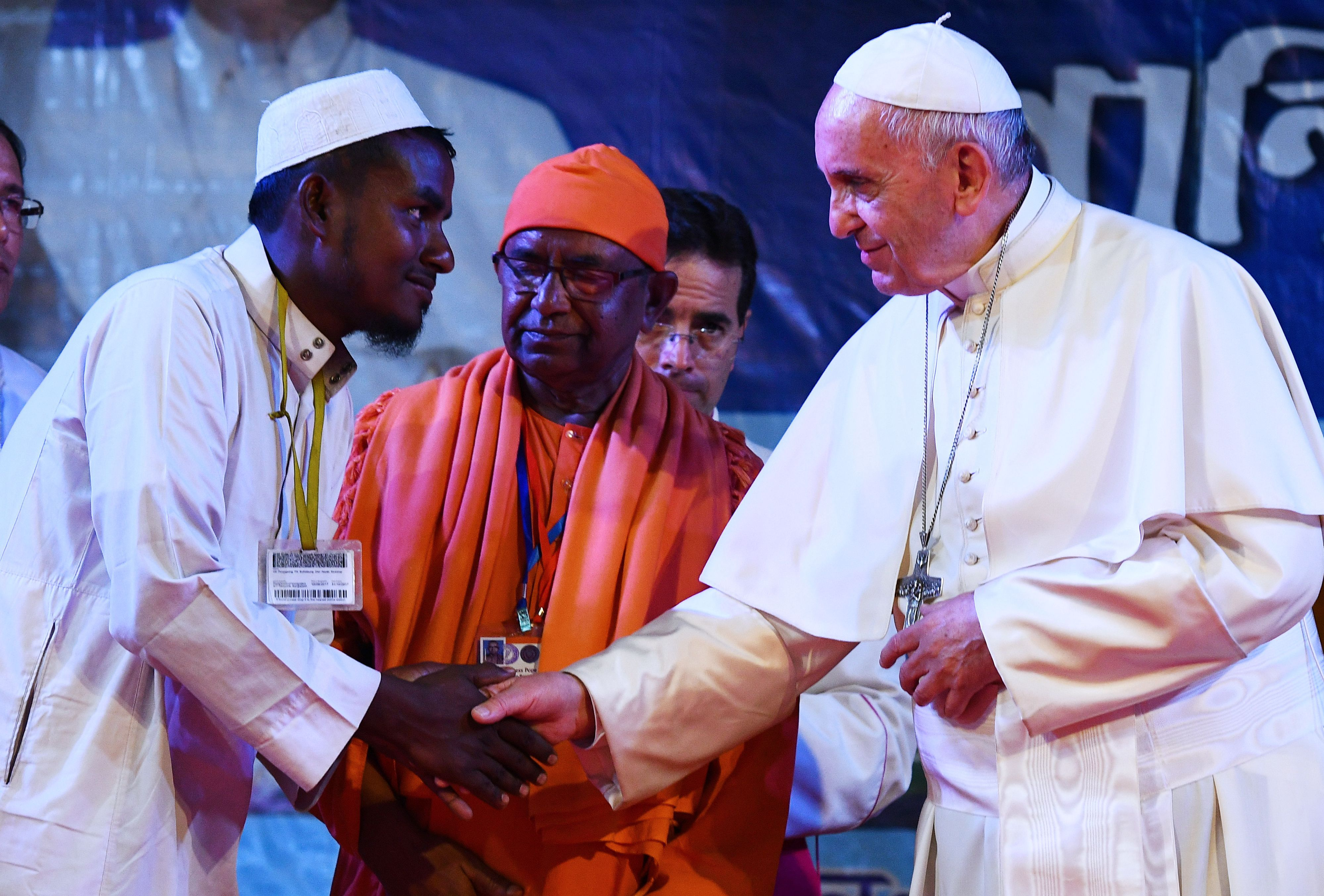 Pope Francis meets with a Rohingya refugee during an interreligious meeting at the Archbishop's house in Dhaka on December 1, 2017.   Pope Francis arrived in Bangladesh from Myanmar on November 30 for the second stage of a visit that has been overshadowed by the plight of hundreds of thousands of Rohingya refugees. / AFP PHOTO / Vincenzo PINTO        (Photo credit should read VINCENZO PINTO/AFP/Getty Images)