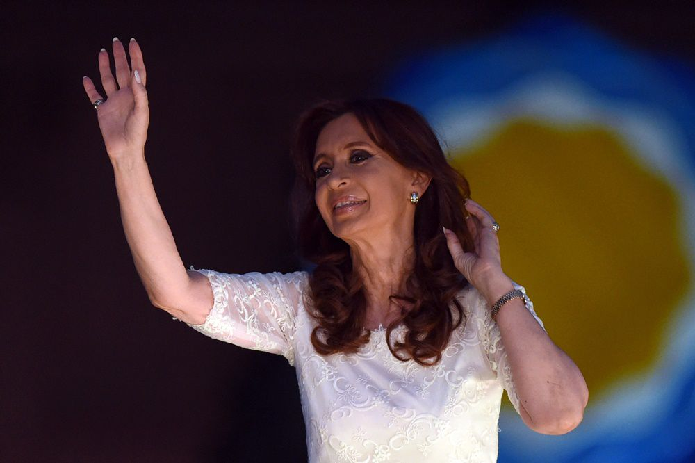 Argentine President Cristina Fernandez de Kirchner waves to supporters after delivering a speech during a farewell rally on her last day in power at Government Palace in Buenos Aires on December 9, 2015. Opposition Mauricio Macri will take on office Thursday as new Argentina president.    AFP PHOTO / EITAN ABRAMOVICH / AFP / EITAN ABRAMOVICH        (Photo credit should read EITAN ABRAMOVICH/AFP/Getty Images)