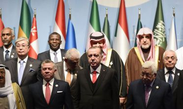 Turkish President Recep Tayyip Erdogan (front row, C) stands next to   Jordan's King Abdullah (L) and Palestinian President Mahmoud Abbas (R) as they pose for a group photo during an Extraordinary Summit of the Organisation of Islamic Cooperation (OIC) on last week's US recognition of Jerusalem as Israel's capital, on December 13, 2017 in Istanbul.  / AFP PHOTO / YASIN AKGUL        (Photo credit should read YASIN AKGUL/AFP/Getty Images)