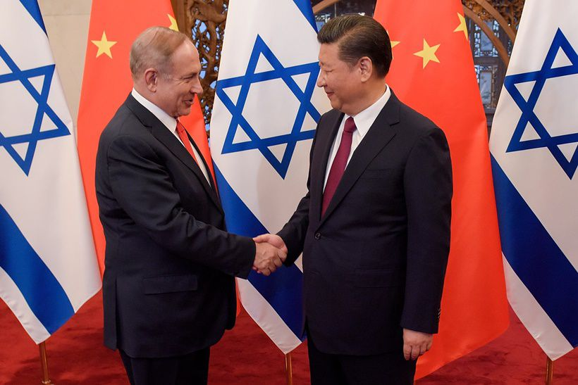 BEIJING, CHINA - MARCH 21:  Chinese President Xi Jinping (R) and Israeli Prime Minister Benjamin Netanyahu (L) shake hands ahead of their talks at Diaoyutai State Guesthouse on March 21, 2017 in Beijing, China.  (Photo by Etienne Oliveau/Pool/Getty Images)