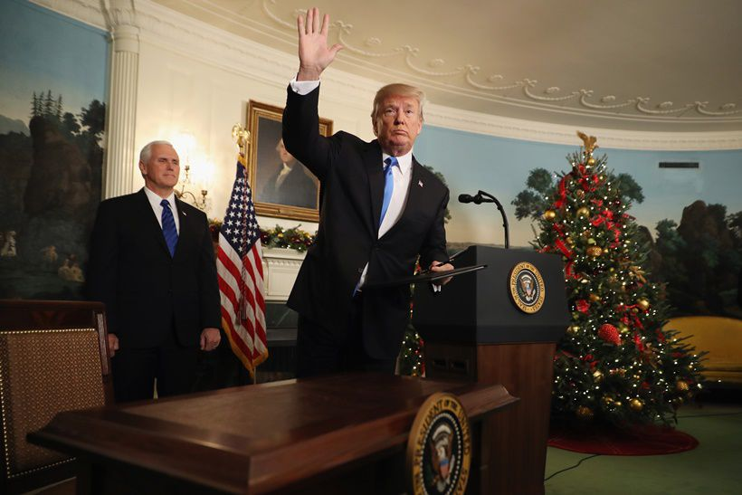 WASHINGTON, DC - DECEMBER 06:  US President Donald Trump waves to reporters, as Vice President Mike Pence (L) looks on, after announcing that the U.S. government will formally recognize Jerusalem as the capital of Israel in the Diplomatic Reception Room at the White House December 6, 2017 in Washington, DC. In keeping with a campaign promise, Trump said the United States will move its embassy from Tel Aviv to Jerusalem sometime in the next few years. No other country has its embassy in Jerusalem.  (Photo by Chip Somodevilla/Getty Images)