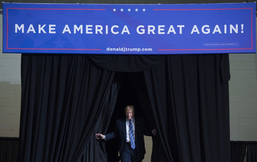 US President Donald Trump arrives to speak at a Make America Great Again Rally at Big Sandy Superstore Arena in Huntington, West Virginia, August 3, 2017. / AFP PHOTO / SAUL LOEB        (Photo credit should read SAUL LOEB/AFP/Getty Images)