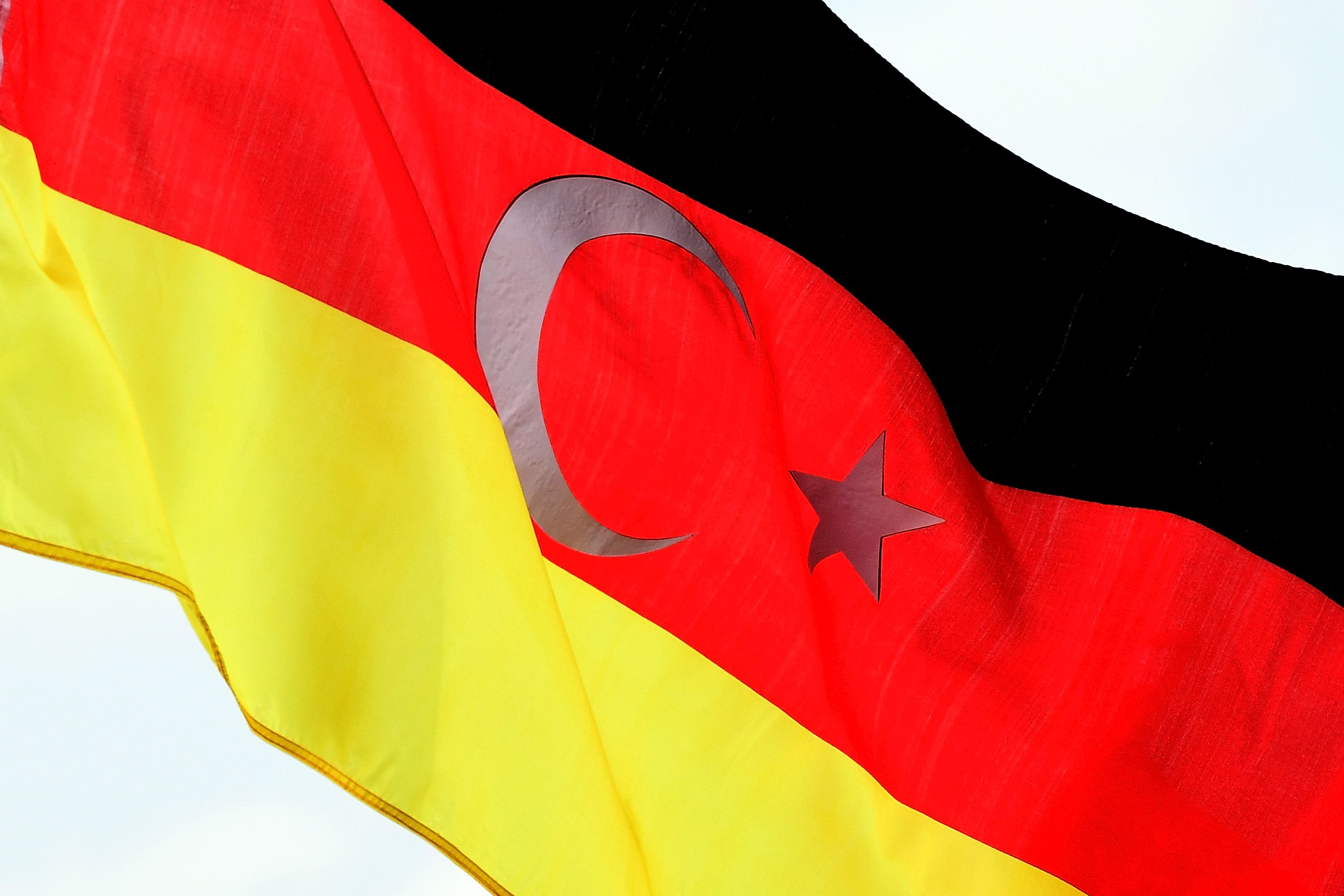 COLOGNE, GERMANY - JULY 31:  A German Turkish flag is seen while supporters of Turkish President Recep Tayyip Erdogan rally at a gathering on July 31, 2016 in Cologne, Germany. Cologne and surrounding cities are home to tens of thousands of people of Turkish descent. Erdogan has pursued strong-handed measures following the recent coup attempt by elements of the Turkish armed forces that include the shuttering of media outlets and the arrest of journalists as well as suspensions of ten of thousands of university professors, public servants and police members.  (Photo by Sascha Steinbach/Getty Images)