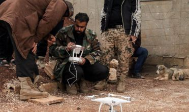 A Syrian rebel fighter operates a DJI Phantom 4 camera drone near the central Syrian rebel-held town of Talbiseh, in the countryside of the central Syrian district of Homs, on April 12, 2017. / AFP PHOTO / MAHMOUD TAHA        (Photo credit should read MAHMOUD TAHA/AFP/Getty Images)