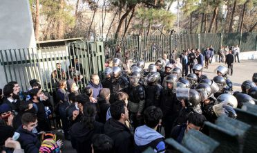 Iranian students scuffle with police at the University of Tehran during a demonstration driven by anger over economic problems, in the capital Tehran on December 30, 2017.  Students protested in a third day of demonstrations, videos on social media showed, but were outnumbered by counter-demonstrators.  / AFP PHOTO / STR        (Photo credit should read STR/AFP/Getty Images)