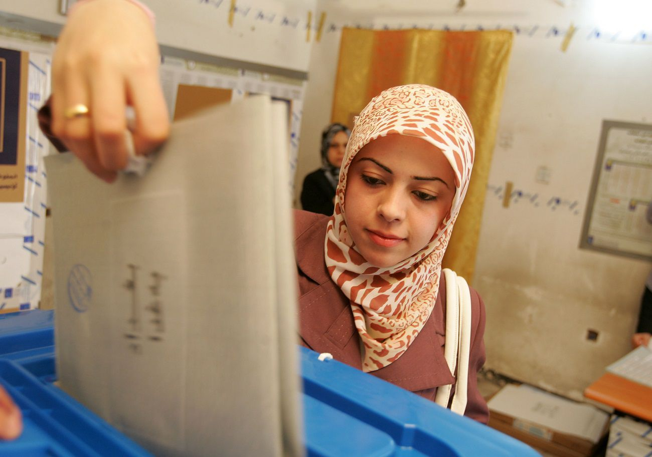 BAGHDAD, IRAQ, MARCH 7: An Iraqi woman casts her ballot for the country's general elections, at a polling station on March 7, 2010 in Baghdad, Iraq. People in 18 Iraqi provinces have started voting to choose their candidates for the 325-seat parliament at about 10,000 polling centers.  (Photo by Muhannad Fala'ah /Getty Images)