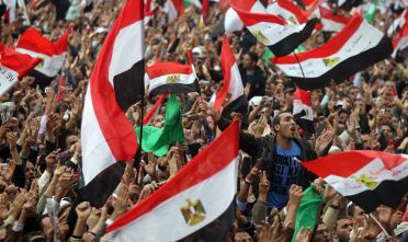 Manifestanti a piazza Tahrir al Cairo, durante le proteste contro Mubarak, inverno 2011 (Foto: KHALED DESOUKI/AFP/Getty Images).