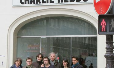 Members of the French satirical newspaper Charlie Hebdo, including cartoonists Cabu (L), Charb (2nd L), Tignous (4th L) and Honore (5th L), Julien Berjeaut aka Jul (R) and Catherine Meurisse (2nd D) posing in front of the headquarters of the weekly in Paris on March 15, 2006.  AFP PHOTO JOEL SAGET        (Photo credit should read JOEL SAGET/AFP/Getty Images)