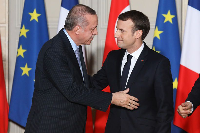 French President Emmanuel Macron (R) and  Turkish President Recep Tayyip Erdogan greet each other during a joint press conference on January 5, 2018, at the Elysee Palace in Paris. Erdogan will attempt to reset relations with Europe at talks with Macron in Paris on January 5 that are likely to be overshadowed by human rights concerns. / AFP PHOTO / POOL / LUDOVIC MARIN        (Photo credit should read LUDOVIC MARIN/AFP/Getty Images)