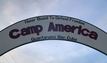 "GUANTANAMO BAY, CUBA - OCTOBER 22: (EDITORS NOTE: Image has been reviewed by the U.S. Military prior to transmission.)   A sign hangs in a U.S. military guard camp at the U.S. prison at Guantanamo Bay, also known as ""Gitmo"" on October 22, 2016 at the U.S. Naval Station at Guantanamo Bay, Cuba. The U.S. military's Joint Task Force Guantanamo is still holding 60 detainees at the prison, down from a previous total of 780. In 2008 President Obama issued an executive order to close the prison, which has failed because of political opposition in the U.S.  (Photo by John Moore/Getty Images)"