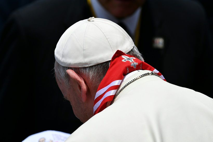 Pope Francis wears a scarf, adorned with a fleur de lys and the Peruvian national colours, given by a boy after delivering his Angelus prayer in Lima on January 21, 2018. Before wrapping up his visit to Peru, Francis will celebrate a mass at Las Palmas air force base in Lima, which is expected to be attended by around one million faithfuls.   / AFP PHOTO / Vincenzo PINTO        (Photo credit should read VINCENZO PINTO/AFP/Getty Images)
