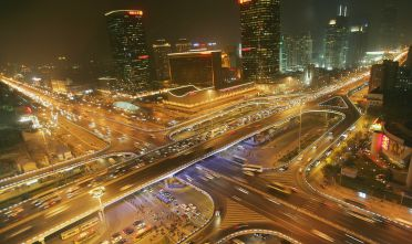 BEIJING, CHINA - NOVEMBER 18: An elevated view of the Central Business District on November 18, 2004 in Beijing, China. With people buying more cars, traffic jams in Beijing continue to be a major problem, despite new roads being built and streets being widened after Beijing won the 2008 Olympics. (Photo by Cancan Chu/GettyImages)