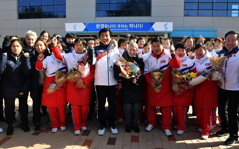 JINCHEON, SOUTH KOREA - JANUARY 25:  Sarah Murray (C), head coach of the two Korea's unified women's ice hockey team , Pak Chol-Ho (4th R) head coach of the North Korean women's ice hockey team and South and North Korean players cheer during a welcoming ceremony after arrive at South Korea's national training center on January 25, 2018 in Jincheon, South Korea.  (Photo by Song Kyung-Seok-Pool/Getty Images)