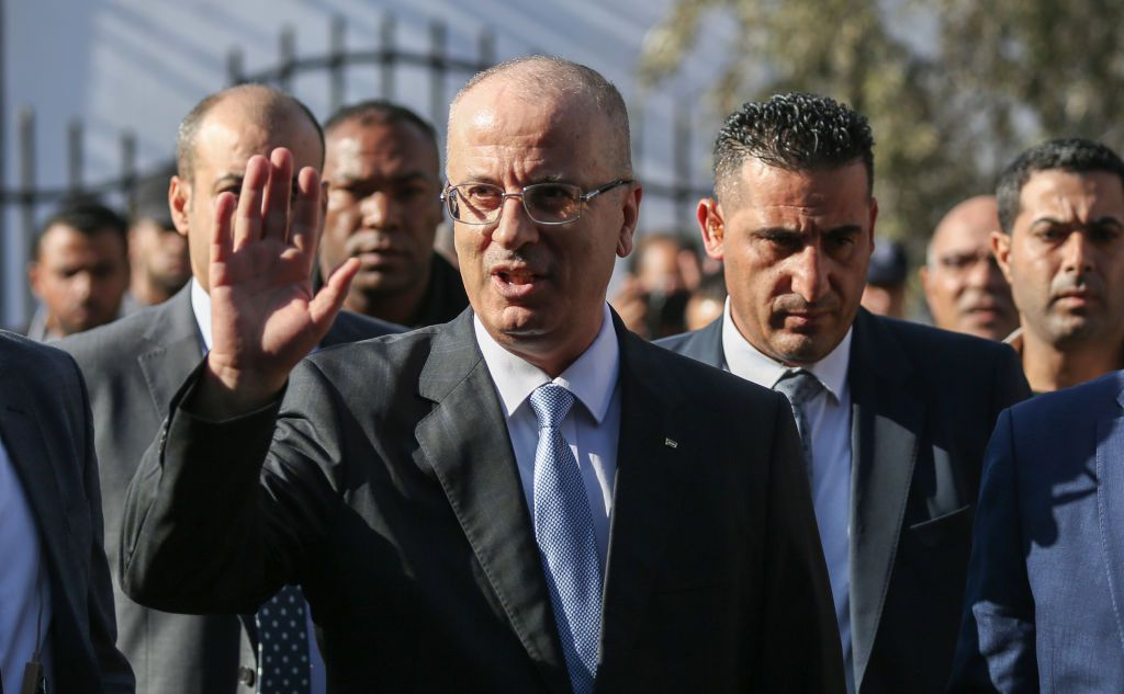 Palestinian Prime Minister Rami Hamdallah arrives to attend a cabinet meeting in Gaza City on October 3, 2017. The Palestinian reconciliation government met in Gaza for the first time since 2014 as moves intensify to end the decade-old rift between the main political factions. / AFP PHOTO / MOHAMMED ABED        (Photo credit should read MOHAMMED ABED/AFP/Getty Images)