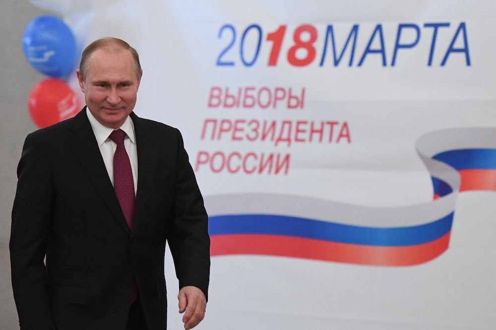 TOPSHOT - Presidential candidate, President Vladimir Putin votes at a polling station during Russia's presidential election in Moscow on March 18, 2018. / AFP PHOTO / POOL / Yuri KADOBNOV        (Photo credit should read YURI KADOBNOV/AFP/Getty Images)