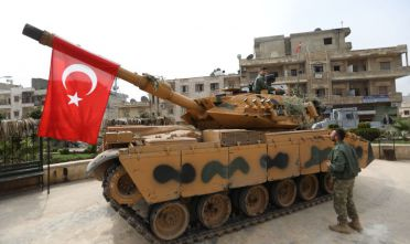 A tank belonging to Turkish soldiers and Ankara-backed Syrian Arab fighters is seen in the Kurdish-majority city of Afrin in northwestern Syria after they took control of it from Kurdish People's Protection Units (YPG) on March 18, 2018. Turkish-backed rebels have seized the centre of Afrin city in northern Syria, Ankara said, as they made rapid gains in their campaign against Kurdish forces. A civilian inside Afrin said that rebels had deployed in the city centre and that the Kurdish People's Protection Units (YPG) militia had withdrawn. / AFP PHOTO / OMAR HAJ KADOUR        (Photo credit should read OMAR HAJ KADOUR/AFP/Getty Images)