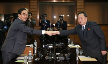 PANMUNJOM, NORTH KOREA - MARCH 29: In this handout photo provided by the Ministry of Unification, South Korean Unification Minister Cho Myoung-Gyon (L) shakes hands with North Korean delegation head Ri Son-Gwon (R) after their meeting on March 29, 2018 in Panmunjom, North Korea. (Photo by Korea Pool/Getty Images)