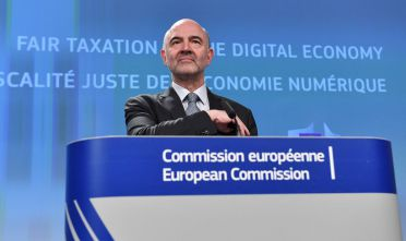 "European Commssioner for Economic and Financial Affairs, Taxation and Customs Pierre Moscovici addresses a press conference at the European Union in Brussels on March 21, 2018. The EU unveiled proposals for a digital tax that targets US tech giants today, bringing yet more problems to Facebook after revelations over misused data of 50 million users shocked the world. ""Our pre-Internet rules do not allow our member states to tax digital companies operating in Europe when they have little or no physical presence here,"" EU Economics Affairs Commissioner Pierre Moscovici said as he explained the proposals.  / AFP PHOTO / EMMANUEL DUNAND        (Photo credit should read EMMANUEL DUNAND/AFP/Getty Images)"