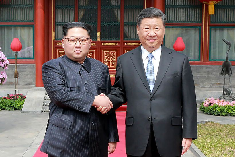 "This picture from North Korea's official Korean Central News Agency (KCNA) taken on March 27, 2018 and released on March 28, 2018 shows China's President Xi Jinping (R) shaking hands with North Korean leader Kim Jong Un in Beijing. North Korean leader Kim Jong Un was treated to a lavish welcome by Chinese President Xi Jinping during a secretive trip to Beijing as both sides seek to repair frayed ties ahead of landmark summits with Seoul and Washington.  / AFP PHOTO / KCNA VIA KNS / - / South Korea OUT / REPUBLIC OF KOREA OUT   ---EDITORS NOTE--- RESTRICTED TO EDITORIAL USE - MANDATORY CREDIT ""AFP PHOTO/KCNA VIA KNS"" - NO MARKETING NO ADVERTISING CAMPAIGNS - DISTRIBUTED AS A SERVICE TO CLIENTS THIS PICTURE WAS MADE AVAILABLE BY A THIRD PARTY. AFP CAN NOT INDEPENDENTLY VERIFY THE AUTHENTICITY, LOCATION, DATE AND CONTENT OF THIS IMAGE. THIS PHOTO IS DISTRIBUTED EXACTLY AS RECEIVED BY AFP.  /         (Photo credit should read -/AFP/Getty Images)"