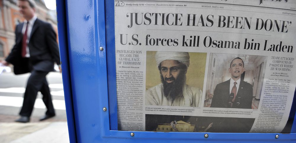 A man walks past a newspaper stand in Washington, DC, on May 2, 2011 with a front page news about the killing of Al Qaeda leader Osama bin Laden by US forces under the direction of US President Barack Obama. Obama Monday hailed a great day for America after Osama bin Laden's death, but Pakistan faced tough questions over the terror kingpin's roomy hideout in a key garrison city. US officials meanwhile said that DNA testing on Bin Laden's corpse before it was buried at sea with Islamic rituals confirmed the identity of the world's most wanted terrorist, the mastermind of the September 11 attacks in 2001. AFP Photo/Jewel Samad (Photo credit should read JEWEL SAMAD/AFP/Getty Images)