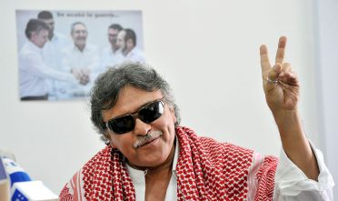 Commander of the FARC-EP leftist guerrillas Jesus Santrich gestures during a press conference in Bogota on December 6, 2016, held to talk about the guerrillas' mobilization to their final concentration zones, where they will hand over their weapons to start their transition to be reinserted into society.  The Colombian government signed a final peace agreement with the FARC rebels on November 26, 2016 that will be implemented over the next six months. / AFP / GUILLERMO LEGARIA        (Photo credit should read GUILLERMO LEGARIA/AFP/Getty Images)