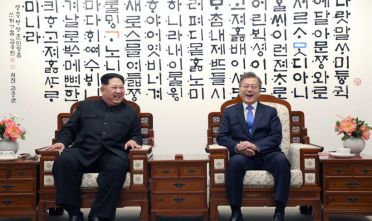 North Korea's leader Kim Jong Un (L) talks with South Korea's President Moon Jae-in (R) before the inter-Korean summit at the Peace House building on the southern side of the truce village of Panmunjom on April 27, 2018. - North Korean leader Kim Jong Un and the South's President Moon Jae-in sat down to a historic summit on April 27 after shaking hands over the Military Demarcation Line that divides their countries in a gesture laden with symbolism. (Photo by Korea Summit Press Pool / Korea Summit Press Pool / AFP)        (Photo credit should read KOREA SUMMIT PRESS POOL/AFP/Getty Images)
