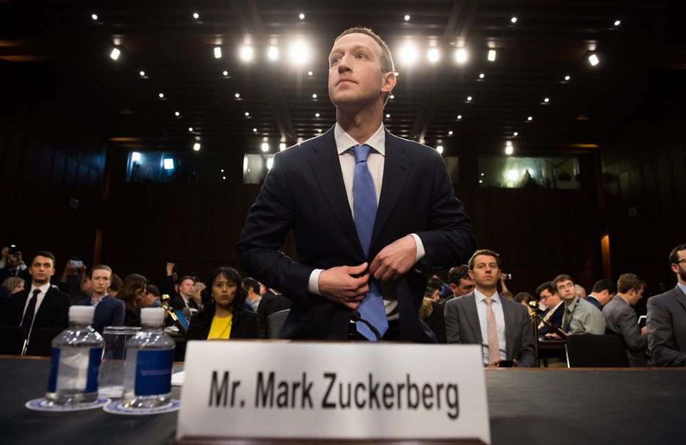 Facebook founder and CEO Mark Zuckerberg arrives to testify following a break during a Senate Commerce, Science and Transportation Committee and Senate Judiciary Committee joint hearing about Facebook on Capitol Hill in Washington, DC, April 10, 2018. Facebook chief Mark Zuckerberg apologized to US lawmakers Tuesday for the leak of personal data on tens of millions of users as he faced a day of reckoning before a Congress mulling regulation of the global social media giant.In his first-ever US congressional appearance, the Facebook founder and chief executive sought to quell the storm over privacy and security lapses at the social network that have angered lawmakers and Facebook's two billion users.  / AFP PHOTO / SAUL LOEB        (Photo credit should read SAUL LOEB/AFP/Getty Images)