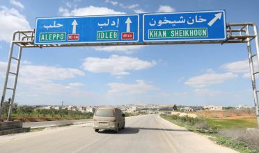 This picture taken on March 31, 2018, shows roadsigns in Khan Shaykhun, on the Damascus-Aleppo highway, where a chemical attack happened on April 4, 2017. On his wedding anniversary this year, 29-year-old Syrian widower Abdulhamid Yusuf will have nothing to remember but a chemical attack that killed his wife and two small children.  / AFP PHOTO / OMAR HAJ KADOUR        (Photo credit should read OMAR HAJ KADOUR/AFP/Getty Images)