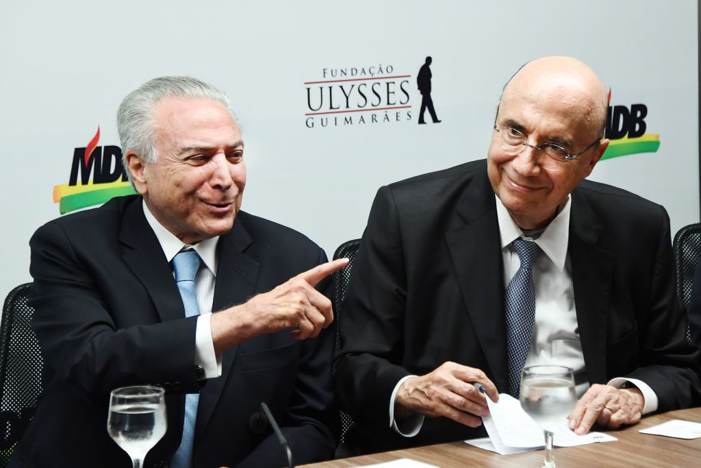 Brazilian President Michel Temer (L) and his Finance Minister Henrique Meirelles are pictured during the latter's affiliation to the Brazilian Democratic Movement (MDB), at the party's headquarters in Brasilia, on April 3, 2018. / AFP PHOTO / EVARISTO SA        (Photo credit should read EVARISTO SA/AFP/Getty Images)