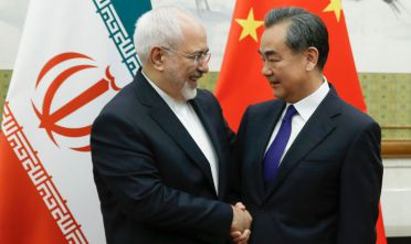Chinese State Councillor and Foreign Minister Wang Yi (R) meets Iran's Foreign Minister Mohammad Javad Zarif at the Diaoyutai state guesthouse in Beijing on May 13, 2018. - Iran's foreign minister arrived May 13 in Beijing on the first leg of a whirlwind diplomatic tour designed to try and rescue the nuclear deal left on the brink of collapse after the US pulled out. (Photo by THOMAS PETER / POOL / AFP)        (Photo credit should read THOMAS PETER/AFP/Getty Images)